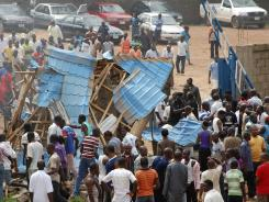 People gather outside a church following a blast in Kaduna, Nigeria, on Sunday.