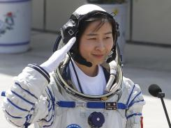 China's first female astronaut, Liu Yang, salutes during a sending-off ceremony at the Jiuquan Satellite Launch Center in Jiuquan, China, on Saturday.