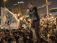Egyptians supporters of the Muslim Brotherhood in Cairo's Tahrir Square on June 18 celebrate the apparent victory of their presidential candidate, Mohammed Morsi.