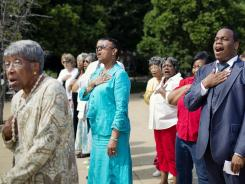 Participants sing the National Anthem during a wreath-laying ceremony to commemorate Juneteenth at the Emancipation Memorial in Lincoln Park in the Capitol Hill neighborhood of Washington, D.C., on June 15