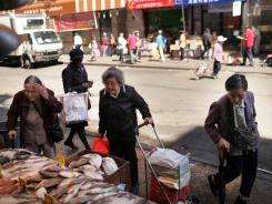 Shoppers buy food in the Chinatown neighborhood in New York.
