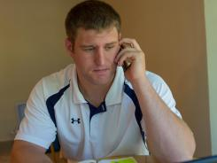 Brett Lutmer, 25, is one of several recent college graduates struggling to get jobs in their disciplines.