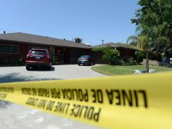 Police investigate the death of Rodney King on Sunday in Rialto, Calif.