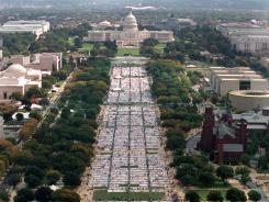 A quilt created in memory of AIDS victims stretches from the Washington Monument to the U.S. Capitol on Oct. 11, 1996.