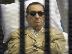 Former Egyptian president Hosni Mubarak is on a gurney June 2 inside a cage in a Cairo courthouse.