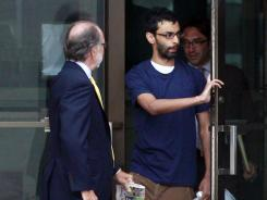 Dharun Ravi, right, walks out of Middlesex County jail with his attorney Steven Altman, in North Brunswick, N.J., on Tuesday.