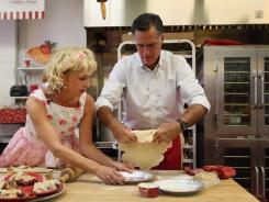 Mitt Romney makes a pie shell with Sweetie-licious Bakery Cafe store owner Linda Hundt in DeWitt, Mich., on Tuesday.