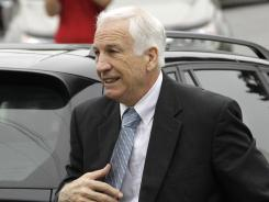Penn State University assistant football coach Jerry Sandusky arrives at the Centre County Courthouse in Bellefonte, Pa., on Tuesday.