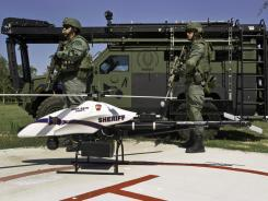 Montgomery County, Texas, SWAT team members gather near a ShadowHawk drone built by Vanguard Industries.