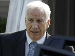 Former Penn State assistant football coach Jerry Sandusky leaves the Centre County Courthouse in Bellefonte, Pa.