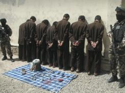 Seven suspected Taliban insurgents are shown in Herat, west of Kabul, Afghanistan, on Wednesday.
