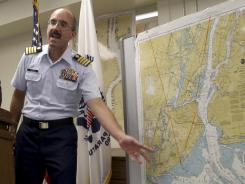 Capt. Gregory Hitchen, of the Coast Guard, gestures toward a map of New York Harbor at Wednesday's news conference in New York.