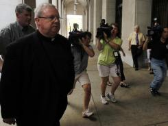 Monsignor William Lynn walks Wednesday from the Criminal Justice Center in Philadelphia, where a jury reported that it is deadlocked.