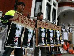 Demonstrators gather on Thursday outside the Ecuadorian Embassy in London. WikiLeaks chief Julian Assange entered the embassy on Tuesday.
