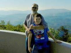 'Tennessean' reporter Bob Smietana, here with his son Eli, has lost 40 pounds in eight months.