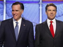 Individuals who supported the failed campaign of Texas Gov. Rick Perry, right, donated to Mitt Romney's camp.