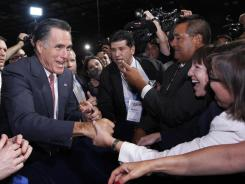 Mitt Romney greets attendees at the National Association of Latino Elected and Appointed Officials conference Thursday in Orlando.