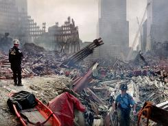 Rescue workers are seen at the World Trade Center site Sept. 24, 2001.
