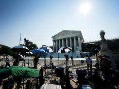 Journalists camp outside the Supreme Court on Thursday in anticipation of a ruling on the health care law. The court did not announce that ruling, however. It adjourns for the summer on June 25.