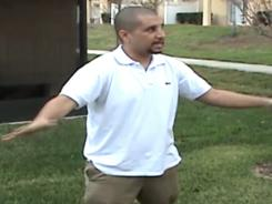 In this Feb. 27 image from a Sanford Police video posted at www.gzlegalcase.com, George Zimmerman speaks to investigators at the scene of Trayvon Martin's fatal shooting.