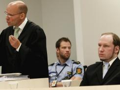 Norwegian right-wing extremist Anders Behring Breivik, right, listens Friday as his lawyer Geir Lipepstad presents his closing argument.