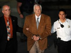 Jerry Sandusky leaves the Centre County Courthouse on Friday after being found guilty in his sexual abuse trial in Bellefonte, Pa.