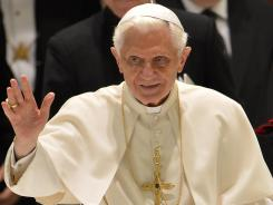 Pope Benedict XVI waves as he arrives for his weekly general audience at the Vatican on June 20. The Vatican is embroiled in a scandal involving leaked confidential documents that has led to the arrest of the pope's personal butler.