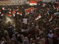 Supporters of Mohamed Morsi, the Muslim Brotherhood's candidate, protest against Egypt's military rulers Friday in Cairo's Tahrir Square.