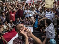 Supporters of Mohammed Morsi, the Muslim Brotherhood's candidate, protest against Egypt's military rulers Saturday in Tahrir Square.