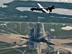 An unmanned airpcraft flies over launch facilities at Kennedy Space Center in Cape Canaveral, Fla.