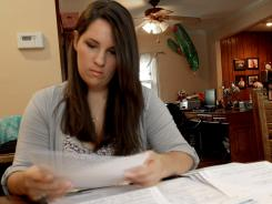 Saddled with $160,000 in student loans, Kathleen Bijas, 27, lives at home with her parents while the $1,608-a-month payments take their toll despite a stable job and comfortable salary.