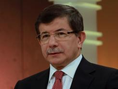 Turkish Foreign Minister Ahmet Davutoglu said Sunday that a jet was downed in international airspace after it mistakenly entered Syria.