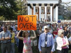 Hundreds gather in front of the University of Virginia rotunda Wednesday for a silent vigil in support of ousted President Teresa Sullivan.