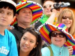 Lisa MacKenzie and Shane Cluff don rainbow hats as they watch San Francisco's 42nd annual Gay Pride parade on Sunday.