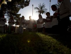 Protesters pray at the Arizona Capitol on Monday before the U.S. Supreme Court's decision on the state's immigration law.