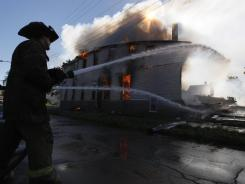Detroit firefighters fight a house fire.