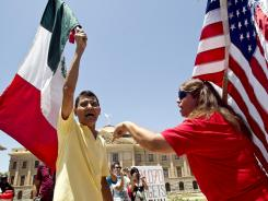 Activists react outside the Arizona State Capitol after the Supreme Court ruled on the state's immigration law.