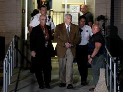 Jerry Sandusky leaves the courthouse Friday after being found guilty of multiple charges of child sexual abuse.