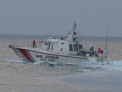 The Turkish coast guard searches on Sunday in the Mediterranean Sea for the Turkish plane that was downed by Syria.