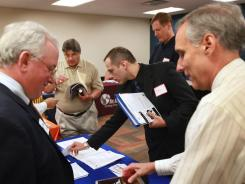 Military veterans search for job opportunities at a job fair being held for veterans at the University of Phoenix on June 21.
