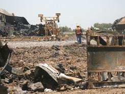 Union Pacific crews work to repair damaged track at the site of a head-on train collision near Goodwell, Okla.