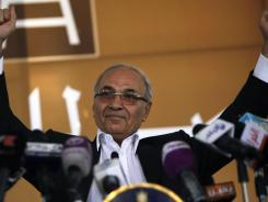 Egyptian presidential candidate Ahmed Shafiq addresses his supporters during a June 14 election rally in Cairo.