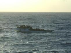 A boat carries asylum seekers north of Christmas Island in the Indian Ocean hours before capsizing Wednesday.
