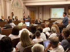The Stockton City Council listens to statements from citizens during a meeting on Tuesday.