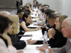 Job seekers have their resumes reviewed at a job fair expo in Anaheim, Calif., on June 13.