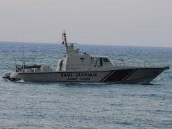 The Turkish coast guard searches the Mediterranean Sea on Sunday for the plane that was downed by Syria.
