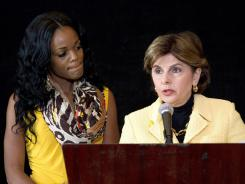 Yovanka Bryant, left, and her lawyer, Gloria Allred, discuss a recent attack on a homeless man by Brant's boyfriend, Rudy Eugene, on June 6.