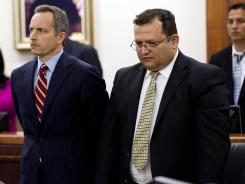 Raul Rodriguez, right, stands with his attorney Bill Stradley as he is found guilty on June 13.