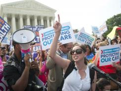Supporters of President Obama's health care legislation celebrate outside the Supreme Court in Washington, D.C.