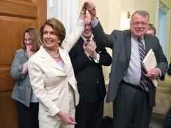House Minority Leader Nancy Pelosi tells her staff that the Supreme Court upheld President Obama's health care law on Thursday in Washington.